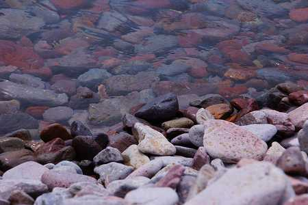 Pebble rocks in the clear water