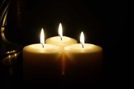 Three candles glowing Banco de Imagens