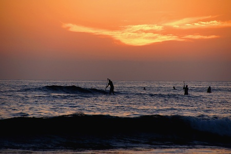 Paddle boarding at sunset on the Pacific