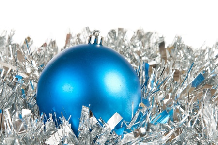 Blue christmas ball over silver tinsel