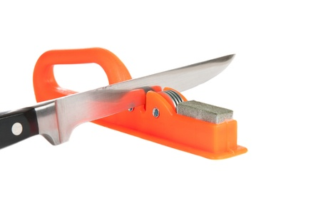 Sharpener and kitchen knife over white background