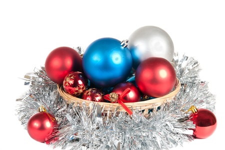 Pile of Christmas balls in a basket over a white background