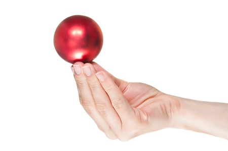 Hand holding a christmas ball against a white background Stock Photo