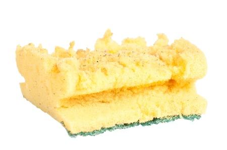 Old kitchen sponge on a white background