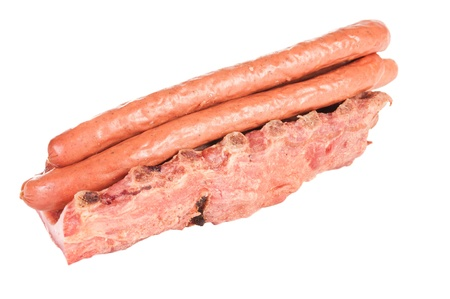 Smoked sausages and pork ribs on white background