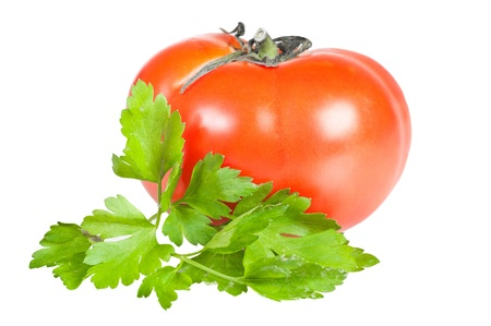 Tomato and parsley leaves on white background