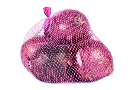Red onions in a pink bag over a white background