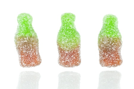 Bottle shaped jellies over a white background with reflection Stock Photo