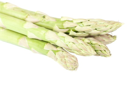 Fresh asparagus over a white background