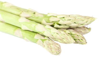 Fresh asparagus over a white background