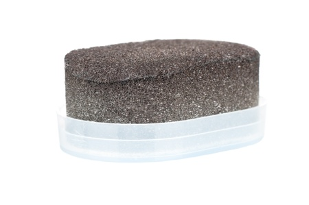 Shoe shine sponge over a white background