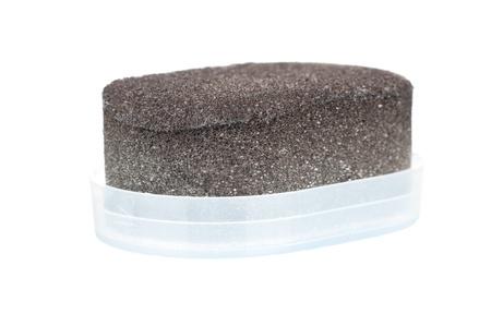 Shoe shine sponge over a white background