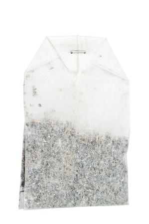 SIngle tea bag over a white background
