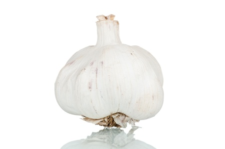 Garlic over a reflective white background