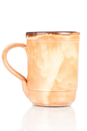 Cup of mud over a white reflective background Stock Photo