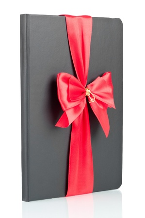 Black notebook with red ribbon over a white background