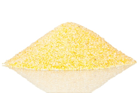 Pile of polenta over a reflective white background