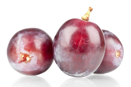 Close up of a red grapes over a reflective background Stock Photo - 18563960