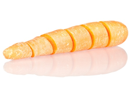Cut carrot over a white reflective background