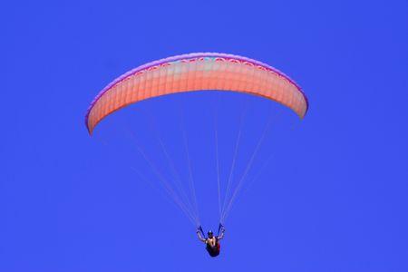 paraglider: Orange Paraglider Stock Photo