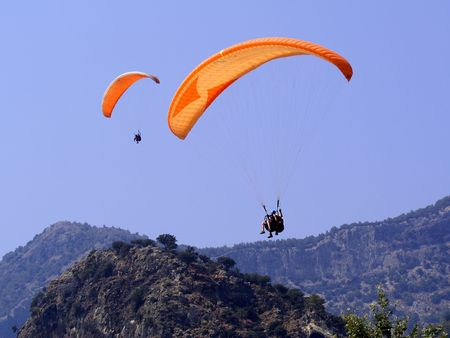 Pair of Orange Paragliders