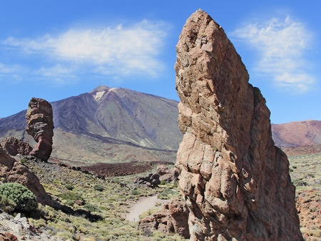 Roques de Garcia, with volcano in the background, in Teide National Park, Tenerife, Canary Islands, Spain .The conical volcano Mount Teide or El Teide in Tenerife is Spains highest mountain. photo