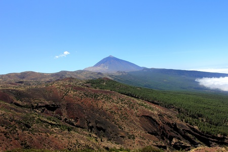 The conical volcano Mount Teide or El Teide in Tenerife is Spains highest mountain. It has featured as the location of many hollywood films and is the premier tourist attraction in the Canary islands  photo