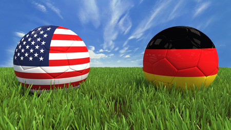 3D soccer balls with usa and germany flag, world football cup 2014  Palaced on 3d grass  Background isolated with clipping path  photo