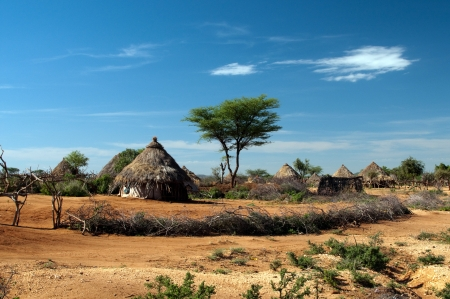 village man: African tribal hut Stock Photo