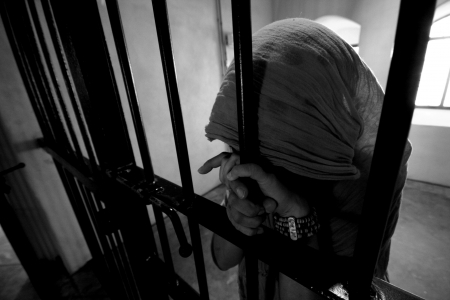 woman prison: Girl behind bars