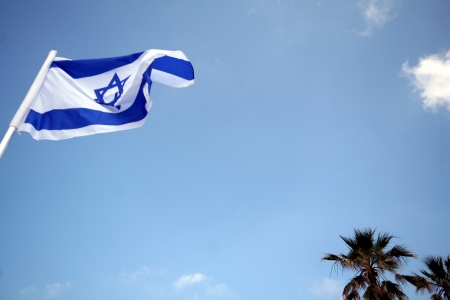 The flag of Israel flying in the breeze  photo