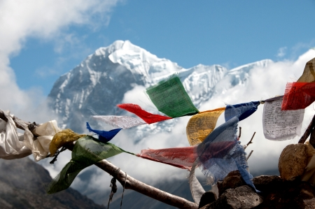 Buddhist flag in himalayan mountains photo