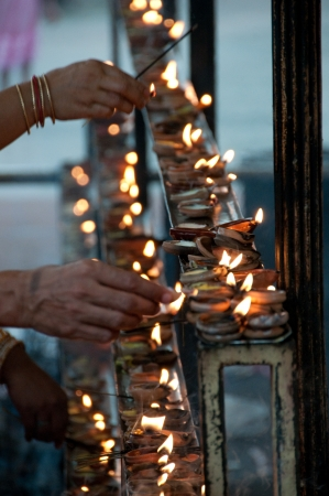 Close up of Candles at Buddhist temple   photo