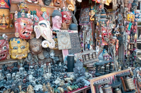 Masks, pottery,souvenirs, hanging in front of the shop, Bhaktapur, Nepal photo