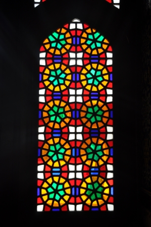 rose window: An old stained glass window of a church in Iran