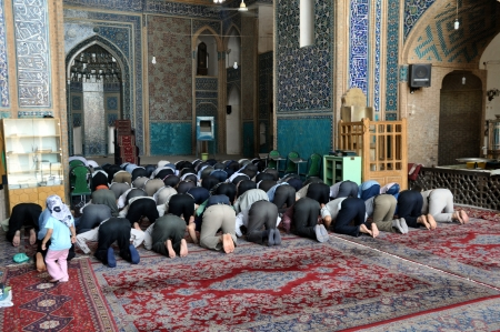 bowing: Muslim Friday mass prayer in Imam Mosque in Isfahan, Iran Editorial