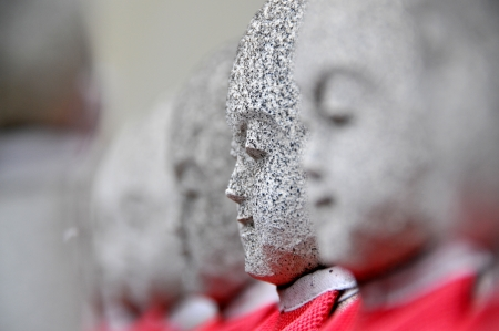 Rows of the small japanese Jizo statues photo