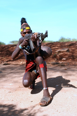 OMO VALLEY-JAN 26 Unidentified Hammer Man with gun in his hand Jan 26, 2012 in Omo Valley, Ethiopia The ethnic groups in the Omo valley could disappear because of Gibe III hydroelectric dam