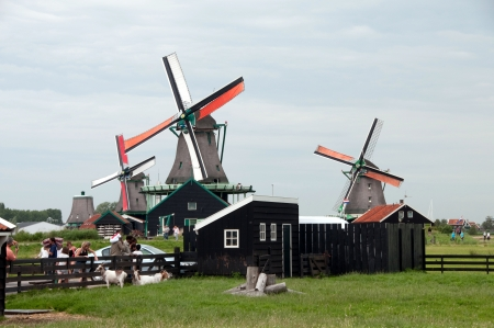 Dutch mill on the waterside photo