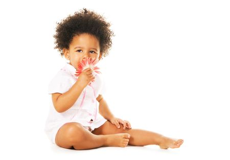 pretty little girl: Pretty little girl smelling a flower  Stock Photo