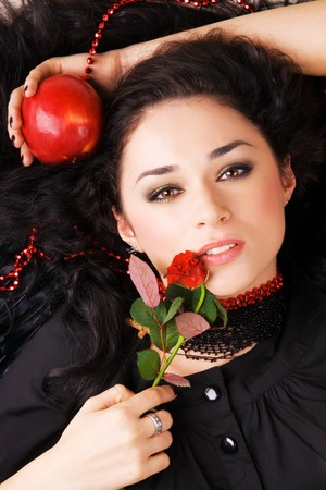 Portrait of a beautiful woman with a red apple and rose Stock Photo - 7106165