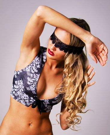Portrait of a sexy beautiful blindfold model on gray background  photo