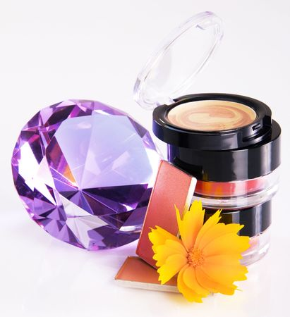 Composition of cosmetic with a flower and crystal  photo