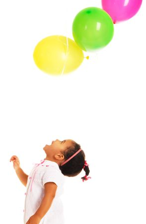 Pretty little girl playing with colorful balloons on white background  photo