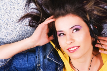Lovely cheerful girl listening a music photo