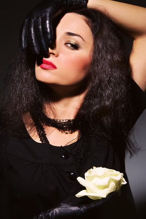 Portrait of seductive brunette with a white rose Stock Photo - 7576863