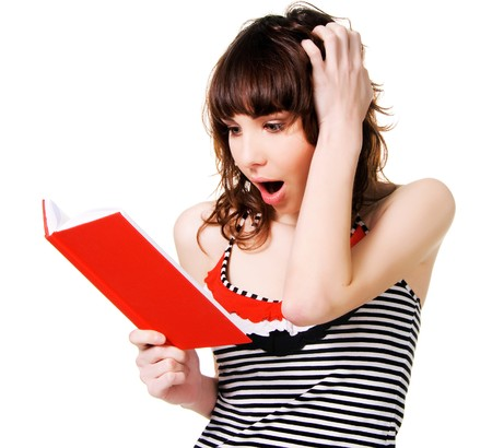 Lovely shocked brunette with a red book on white background  Stock Photo