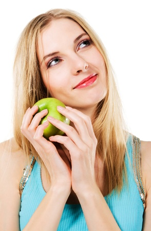 Young beautiful woman with green apple against white background photo