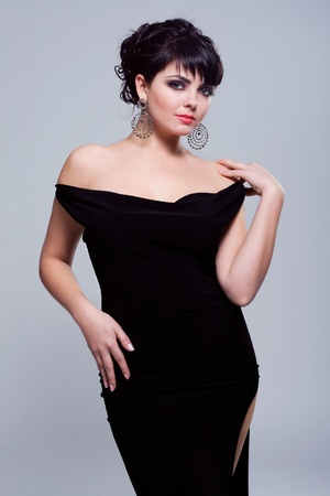 Portrait of a gorgeous woman in black dress photo