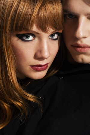 Closeup fashion portrait of a young couple photo